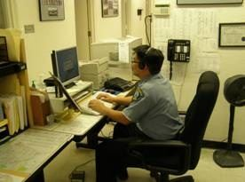 Police Record Technician working in office