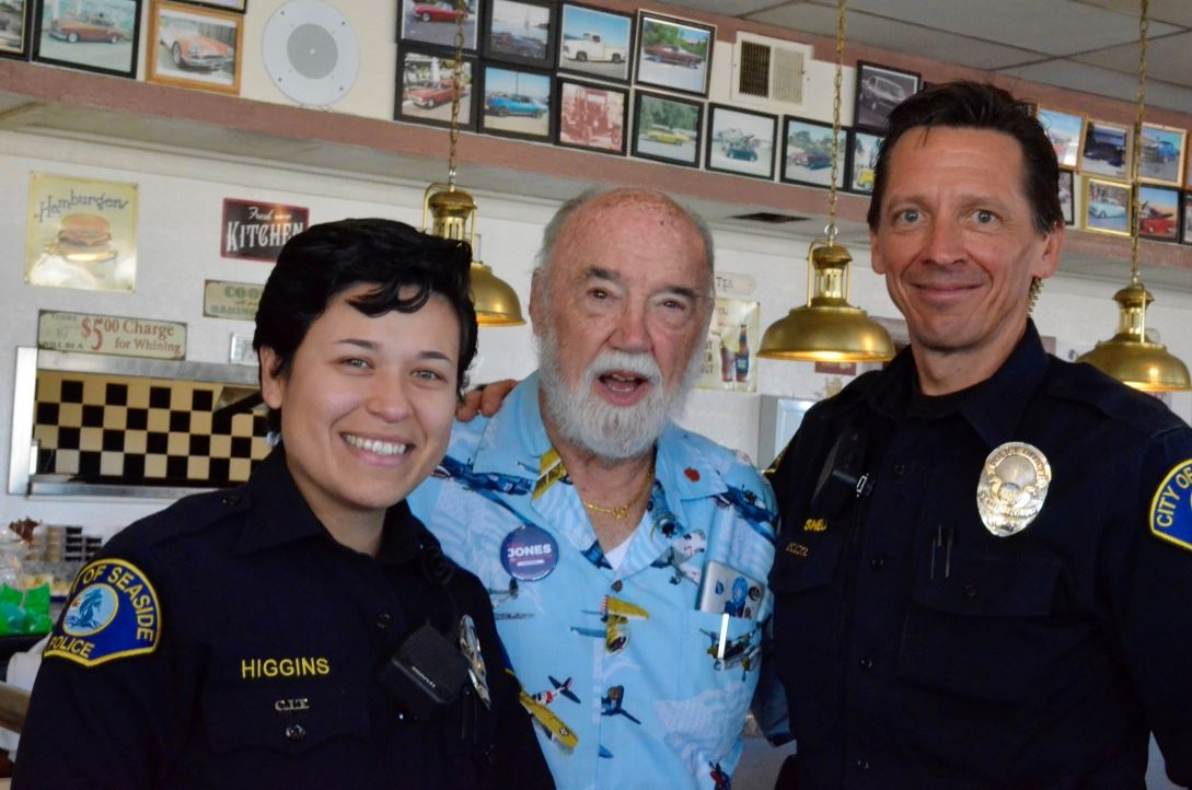 Police Officers with resident during Coffee with a Cop event