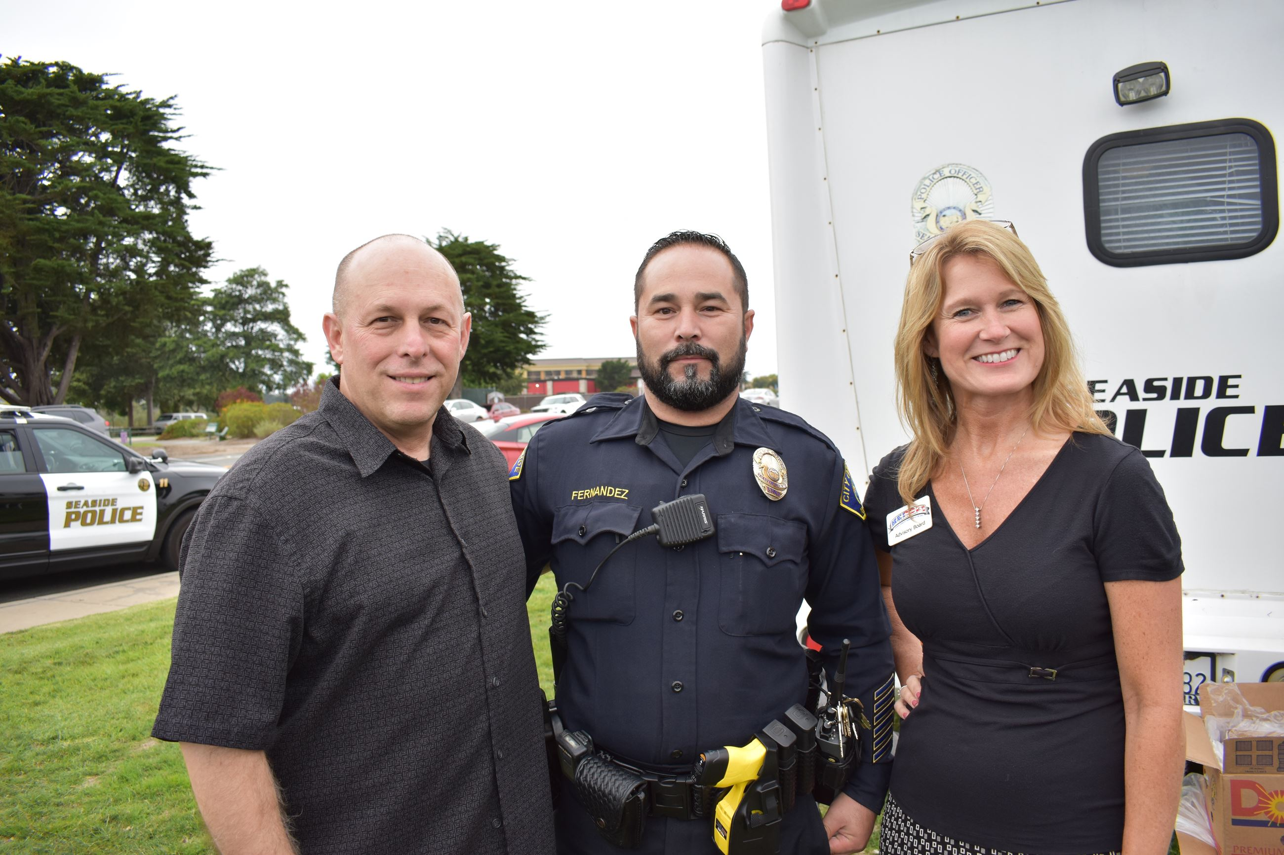 Officer and attendees at National Night Out event