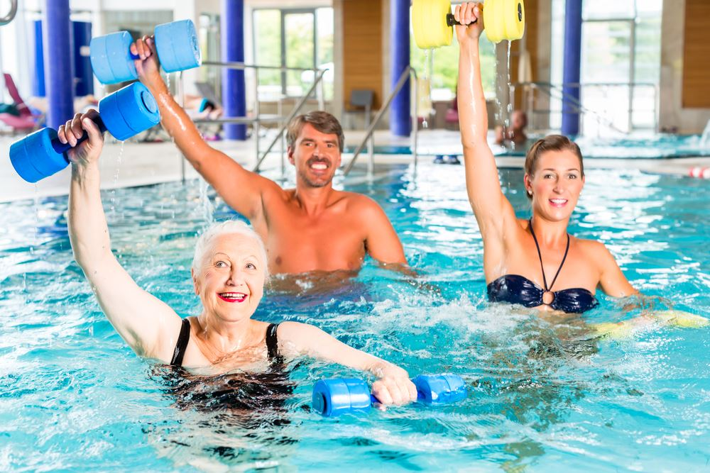 Seniors in water aerobics class